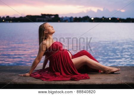 Maternity Portrait Of A Woman Wearing Red