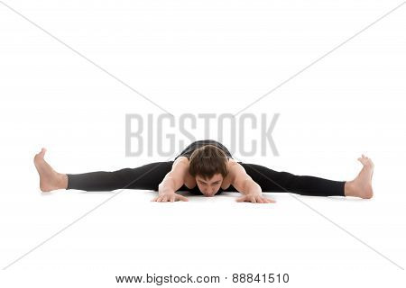 Athletic young man doing yoga pilates stretching practice sitting in splits Upavistha Konasana Wide Angle Seated Forward Bend poster
