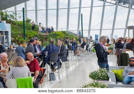 People in the restaurant of the Sky Garden Walkie-Talkie building. View