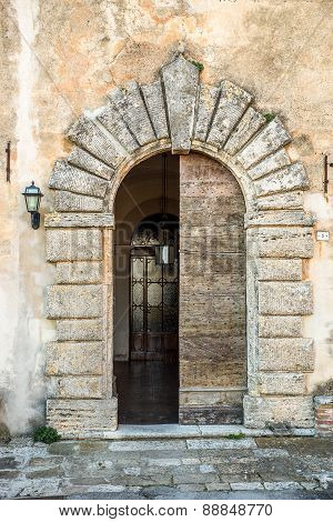 Entrance doors of an old church in Tuscany, Italy poster