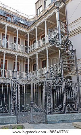 Tbilisi,Georgia-Feb,26 2015:House with traditional balconies and wrought-iron spiral staircase