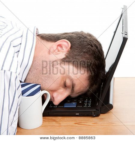 Businessman Asleep At His Computer