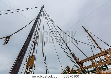 Planks, ropes, pulleys, tackle, and rigging of an old replica sailing ship