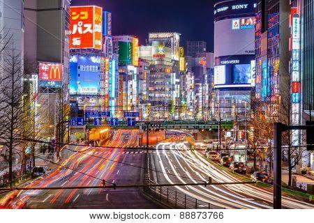 TOKYO, JAPAN - DECEMBER 29, 2012: Shinjuku district illuminated at night. The district is a renown night life center.