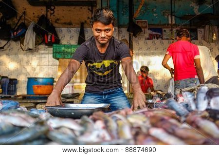 MUMBAI, INDIA - 08 JANUARY 2015: Worker at a fishmarket posing while waiting for customers.