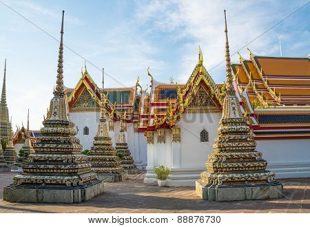 Wat Pho temple, Bangkok, Thailand. Wat Pho, is a Buddhist temple in Bangkok, Thailand. It is located directly adjacent to the Grand Palace. Known also as the Temple of the Reclining Buddha. poster