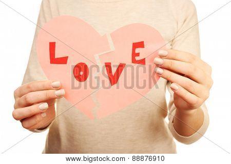 Woman holding broken heart close up