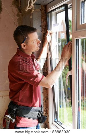 Construction Worker Installing New Windows In House poster