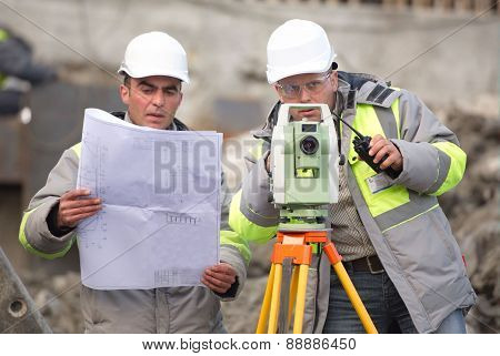Civil Engineer And Surveyor At Consruction Site