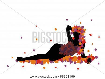 Sexy silhouette of a girl lying on leaves