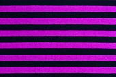 Texture of pink and black striped fabric background poster