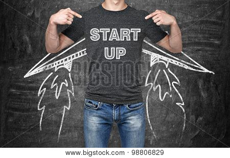 A Businessman Is Pointing Out In The Chest Where Is A Word Collocation ' Start Up '. A Concept Of Th