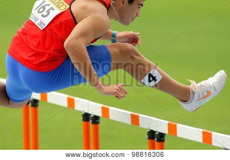 BARCELONA - JULY, 10: Patricio Colarte of Chile during 110m hurdles event of the 20th World Junior Athletics Championships at the Stadium on July 10, 2012 in Barcelona, Spain
