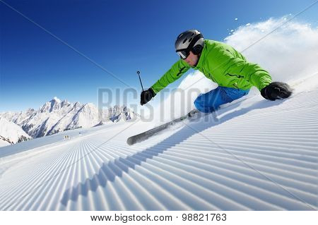 Skier on pise in high mountains.