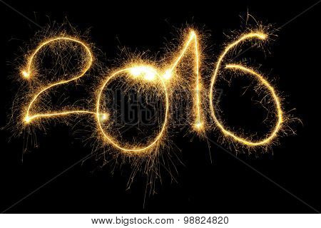 New Year 2016 formed from sparking digits over black background