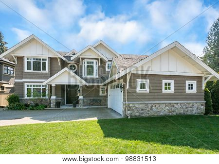 Luxury house with beautiful landscaping on a sunny day. Home exterior. poster