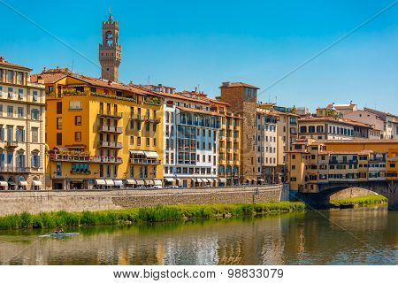Quay of the River Arno and Ponte Vecchio, Arnolfo tower of Palazzo Vecchio in the background, Florence, Tuscany, Italy poster