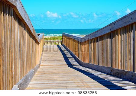 Wooden walk to the ocean beach