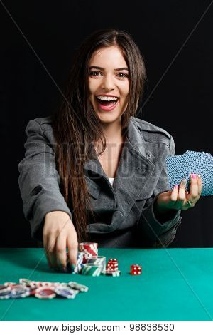 Pretty lady winning blackjack game at casino