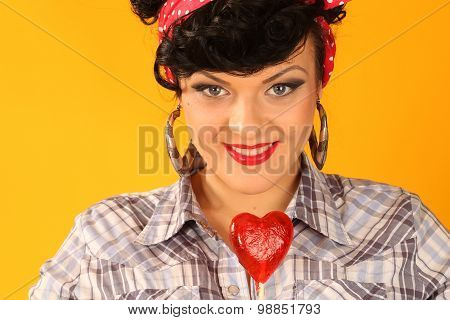 beautiful brunette with heart shapped candy pop