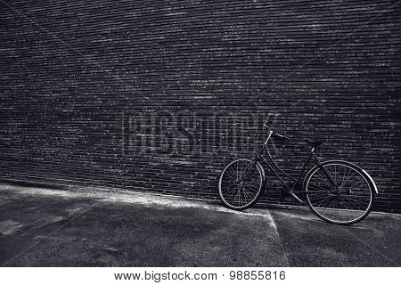 Classic Vintage Hipster Bicycle Leaning Against The Street Wall