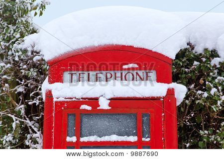 Red British Phonebox Covered In Snow