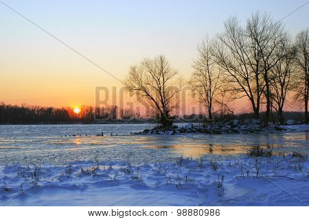 Sunset on the shore of the great river Dnieper in winter, Ukraine