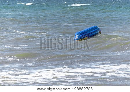 Capsized Inflatable Boat  In The Sea