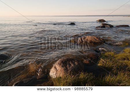 Calm evening at rocky sea shore in Lahemaa National Park, Estonia. poster