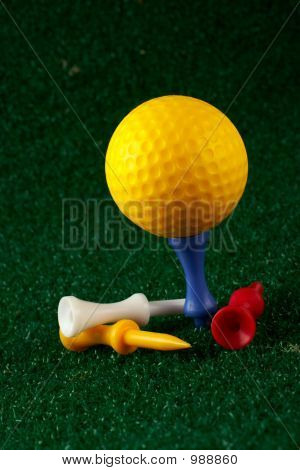 Yellow Golfball And Tees