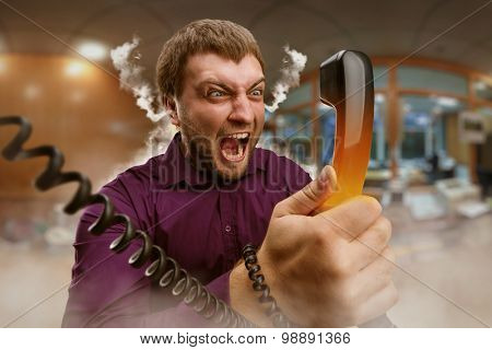 Angry man speaks on the phone