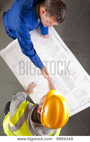 Builders Shake Hands Over Blueprint
