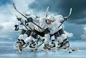 Ice hockey player in action outdoor around mountains poster