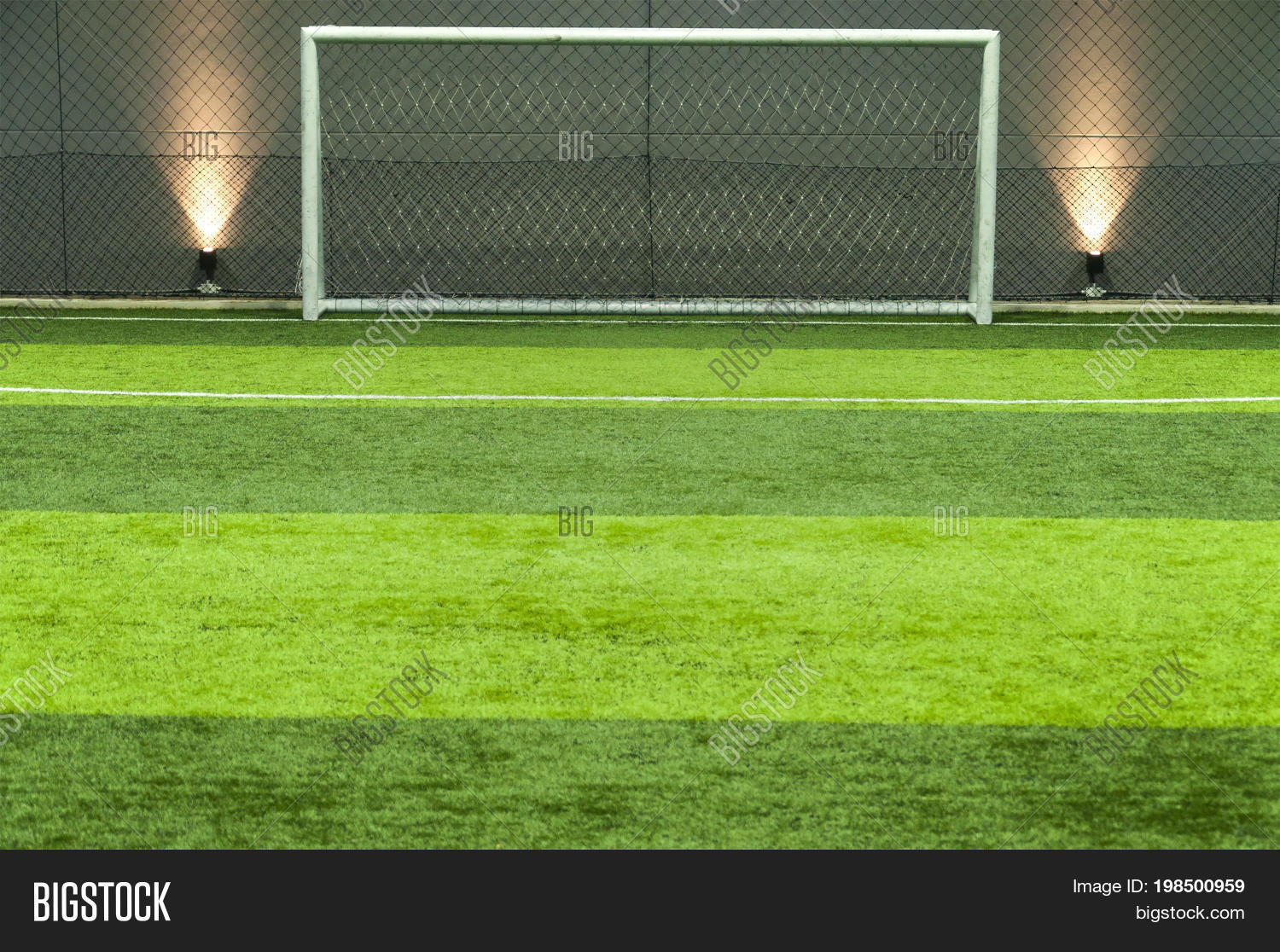 grass soccer field with goal.  Goal Green Grass Soccer Or Football Field And Goal Post Background In With