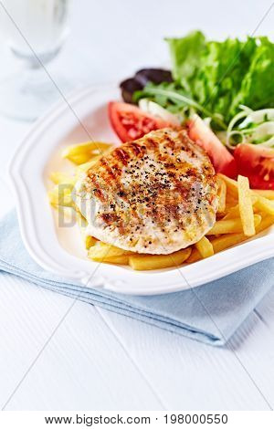 Grilled turkey breast fillet with salad and french fries