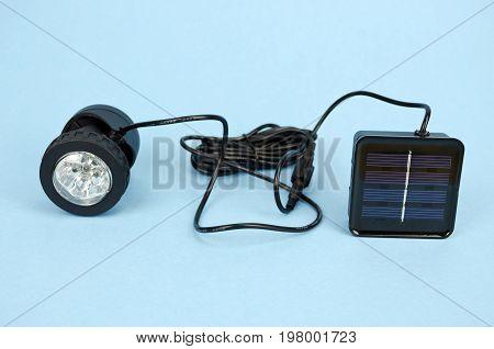 Black new solar lamp on blue background