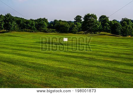 Golf Course On A Beautiful Day, Green Grass, Lush Vegetation, Golf Holes, A Place For Active Recreat