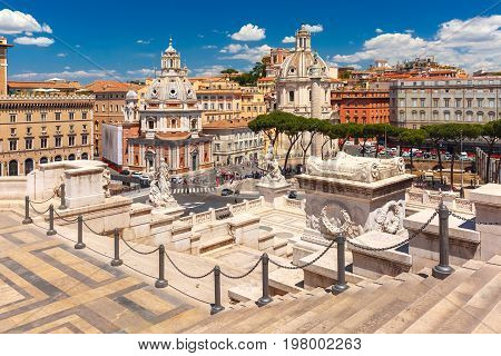 Piazza Venezia, Ancient ruins of Trajan Forum, Trajan Column and churches Santa Maria di Loreto and Most Holy Name of Mary as seen from Altar of the Fatherland in Rome, Italy
