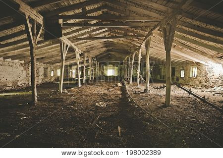 Abandoned warehouse building or barn for livestock factory, toned