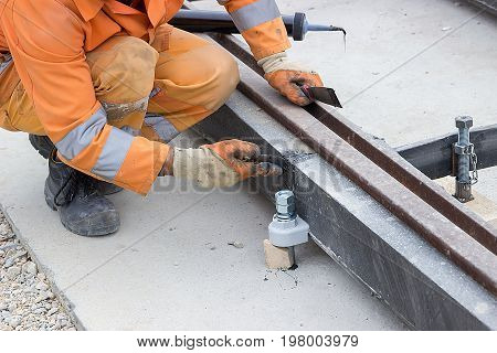 Worker Applying Silicone Sealant With Putty Knife