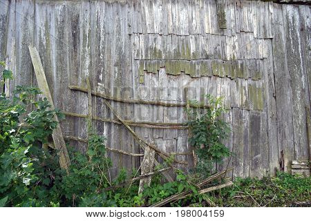 Old wooden derelict rural barn wall background