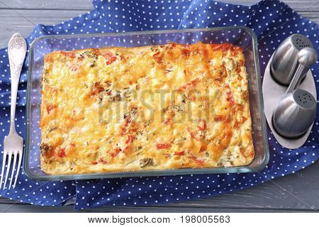 Composition with delicious turkey casserole on wooden table