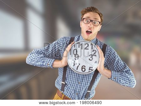 Digital composite of man holding clock in front of blurred background