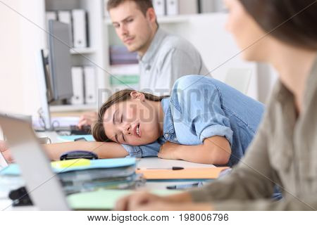 Fatigued Employee Sleeping At Office
