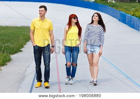 Group Of  Three Young Friends Walking In The City.