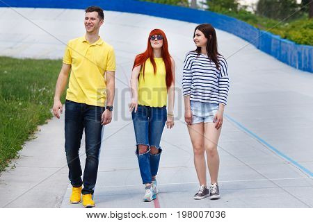 Group Of Young Friends Walking In The City.