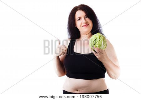 Young Overweight Smiling Woman Agitating For Healthy Food With C