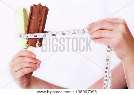 Woman Hands Putting Measuring Tape Around Ice Cream Bar, Close-u