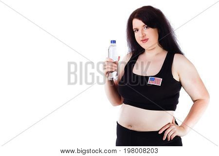 Young Overweight Thirsty Woman With A Bottle Of Water, Studio S