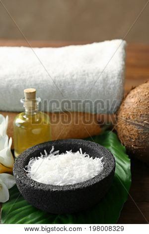 Bowl with desiccated coconut for spa treatments, closeup